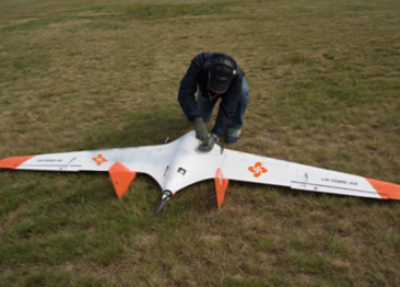 Preparing an AU-200 Stealth Wing UAV drone for operation